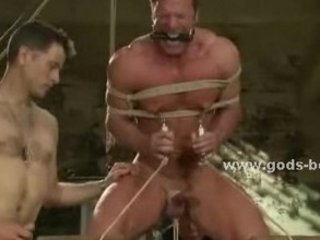 strong chest of a homo is tied in thick rope