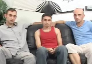 tatooed friends threesome on sofa