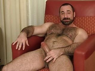 bearded homosexual hunk jerks off his fat boner