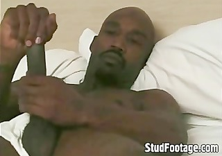 sexy darksome guy jerking off in his daybed