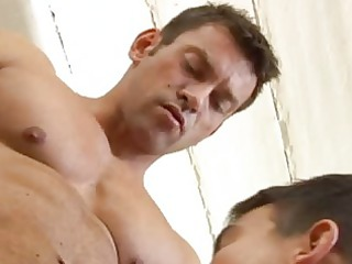gay muscle dude receives his hard dick sucked off