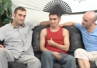 tatooed friends three-some on couch