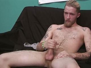 homosexual tattooed stud masturbates for camera